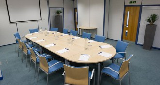 Shot of Garda room with boardroom layout at The Ark Conference Centre in Basingstoke Hampshire