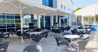 Parasol and Chairs on the Patio at The Ark Conference Centre
