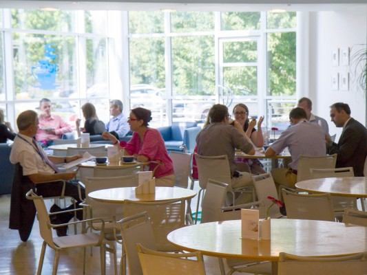 People sat relaxing enjoying food and drink in the Bluecafe Bar at The Ark Conference Centre